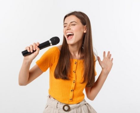 young-pretty-woman-happy-motivated-singing-song-with-microphone-presenting-event-having-party-enjoy-moment_1258-5909